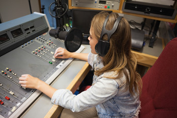 Concentrating pretty radio host moderating