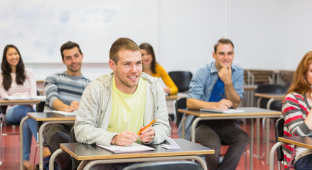 Young students smiling in classroom