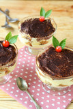 three tiramisu dessert on wooden table