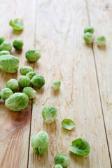 Brussels sprouts scattering on wooden table