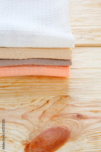 stack of cotton kitchen towel on wooden table