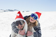 Close-up of a cheerful couple in ski goggles on snow