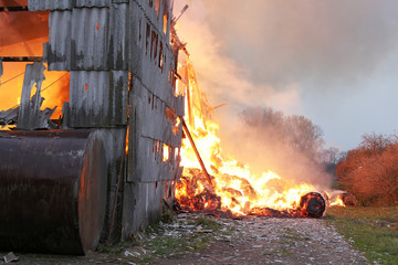 Burning farm building with hay