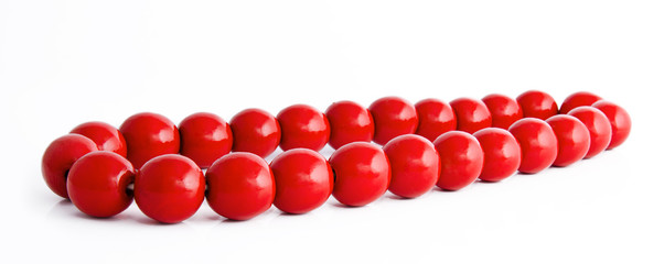 Wooden red beads on a white background