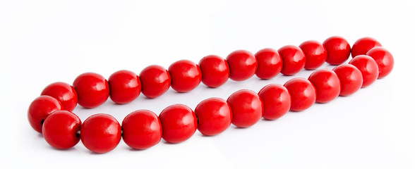 Wooden red beads isolated