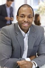 Portrait of confident businessman smiling