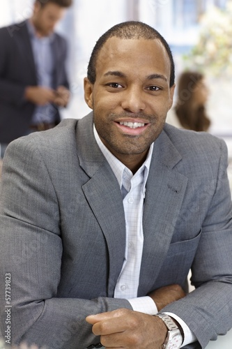 Portrait of confident businessman smiling