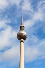 TV tower spire with blue cloudy sky