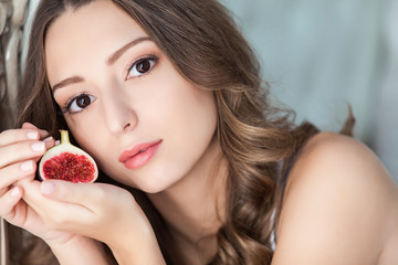 Attractive woman with a fig