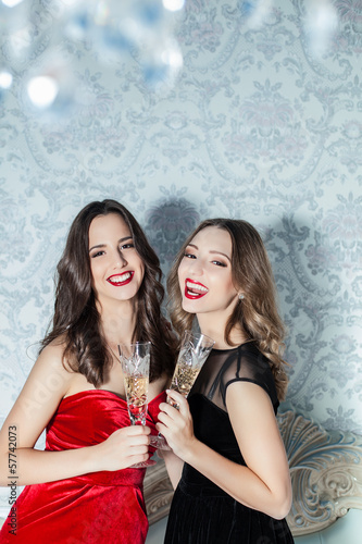 elegant young womans with champagne glasses at celebration