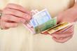 Hands counting money bills