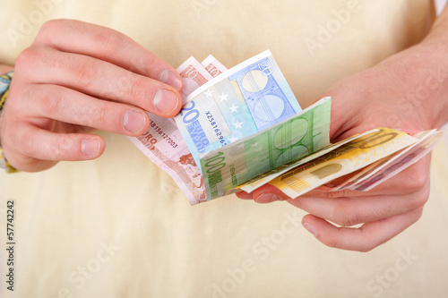 Hands counting money bills
