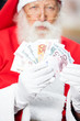 Santa Claus Holding Money
