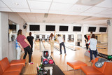 Young Friends Bowling in Club