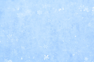 Blue sparkling snow background.