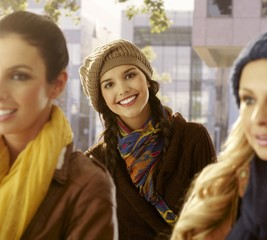 Outdoor portrait of young woman and friends