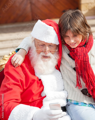 Boy And Santa Claus Using Smartphone