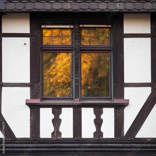 window reflection in half timbered house