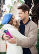 Romantic Couple Embracing At Christmas Store