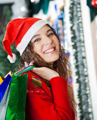 Beautiful Woman Carrying Shopping Bags At Christmas Store