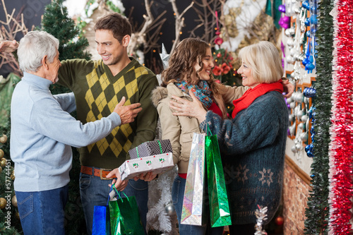 Happy Family Embracing In Christmas Store