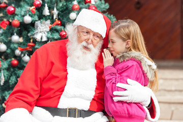 Girl Telling Wish In Santa Claus's Ear