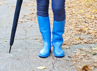 Girl with rubber boots and umbrella