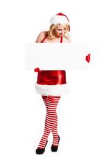 attraktive blonde Weihnachtsfrau mit Schild als Textfreiraum
