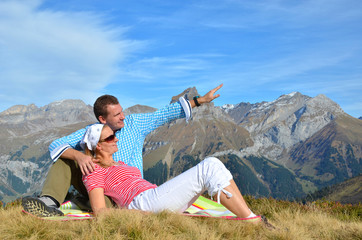 Young couple enjoying Alpine panorama. Switzerland