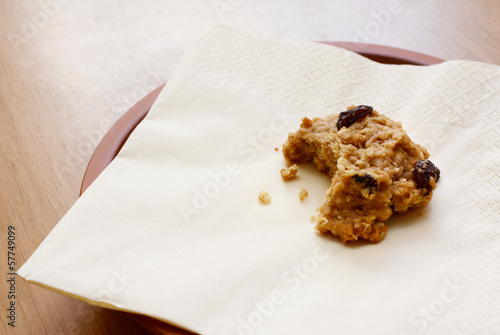 Oatmeal raisin cookie with a bite taken