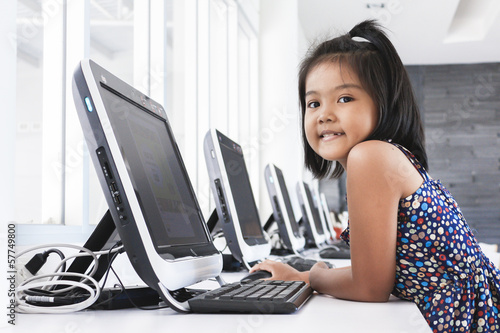 Little girl playing computer