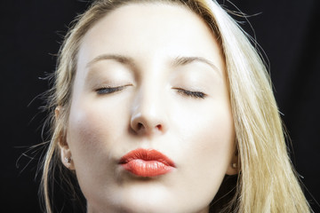 Kissing girl with closed eyes portrait color image