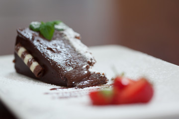 Close up of chocolate cake with strawberries