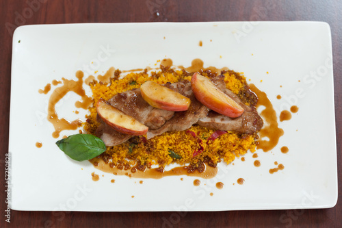 Overhead view of couscous dish with meat