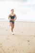 Woman jogging on a calm beach