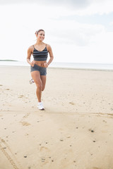 Woman jogging on a calm beach