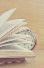 Open book and clock