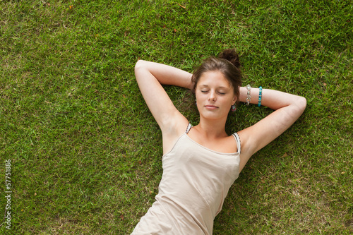 Woman resting on grass at the park