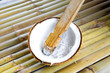 grate coconut on bamboo