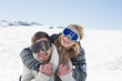 Cheerful couple in ski goggles on snow