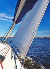 Sailboat in action, extreme sport, autumn cruise on the lake, ac
