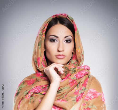 Portrait of a young and beautiful orthodox woman wearing a scarf