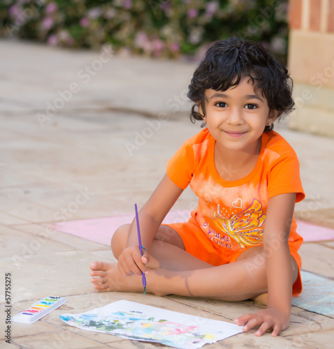 Little Child Painting on a Patio