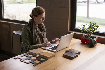 Woman working from home office studio, horizontal