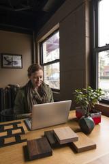 Woman working in home office studio, vertical