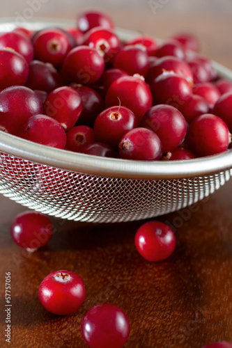 Red berries in strainer