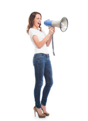 A Caucasian woman in stylish jeans screaming on the megaphone
