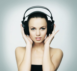 A teenage girl listening to the music in headphones