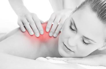 A woman getting shoulder massaging treatment