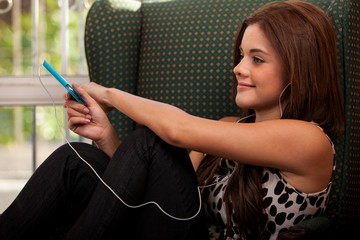 Pretty girl listening to a song